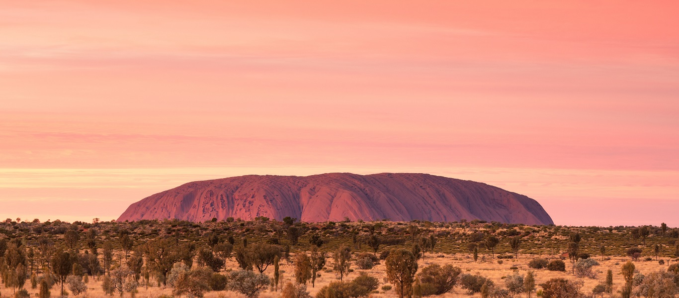 Changing colours of Uluru at sunrise
