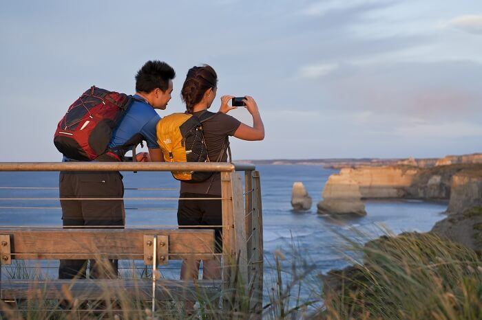 Couple photographing the twelve apostles