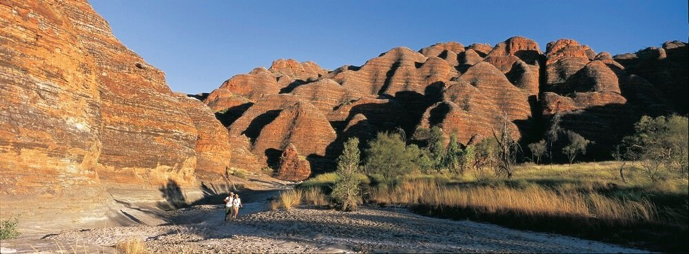 Couple hiking in Purnululu National Park (Bungle Bungle Range)